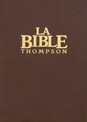 Illustration: Bible Thompson couv. souple brune, tranche dorée, sans onglets, paroles de Jésus en rouge.